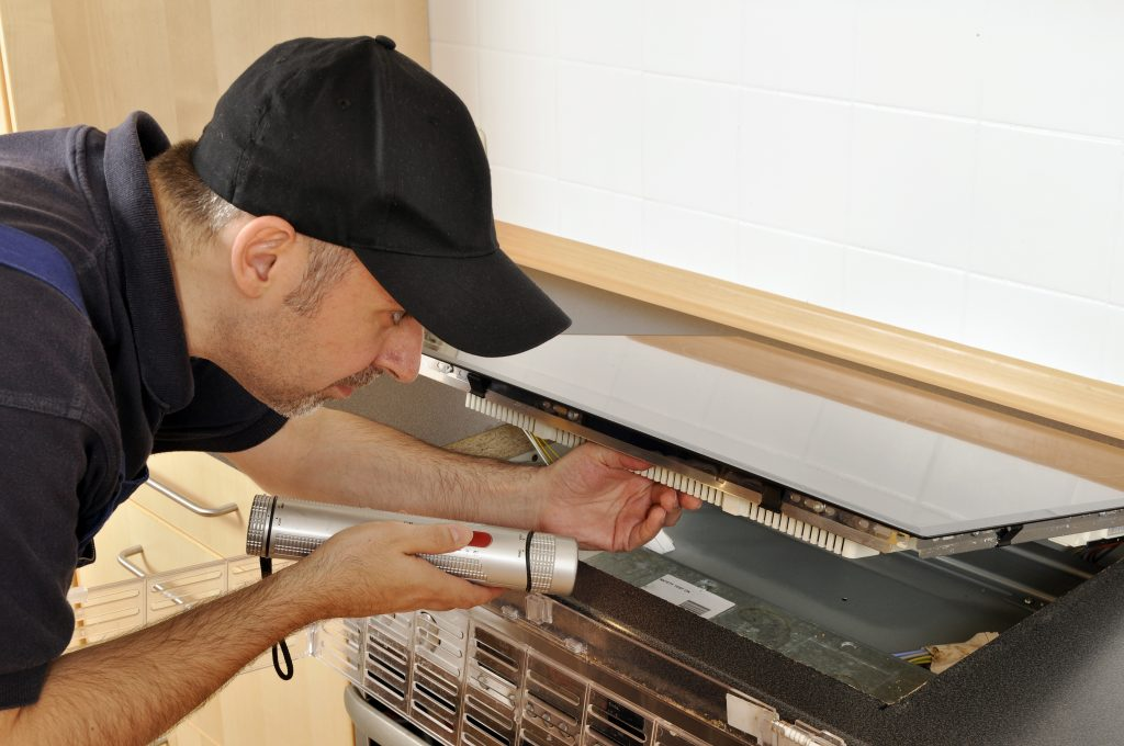 HVAC technician repairing an indoor system