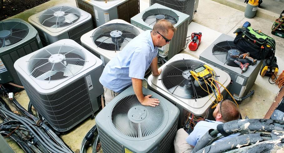 HVAC technicians testing old air conditioners